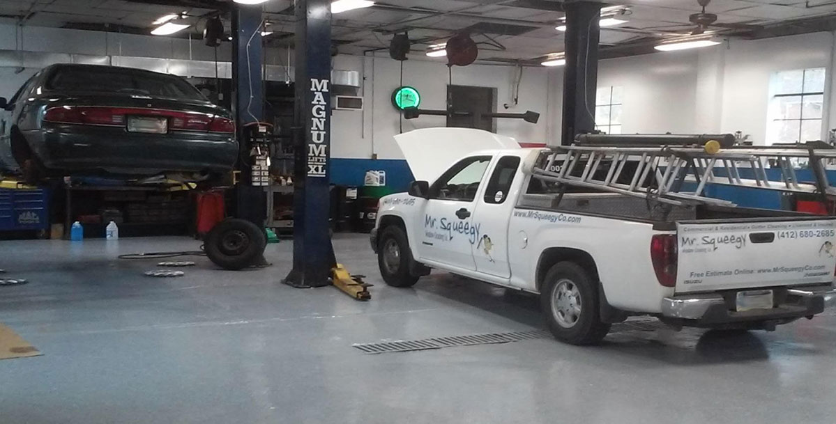 Two Vehicles Being Worked on