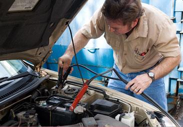 Mechanic Boosting Car Battery